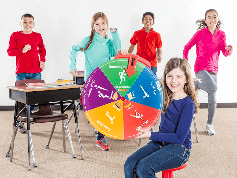 SPARK students spin a wheel to decide what activity they're doing.